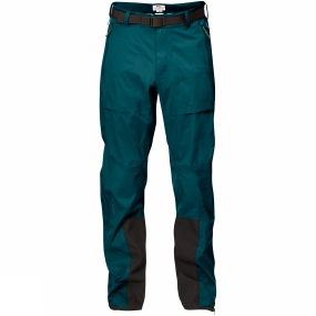 Fjallraven Wind and waterproof three-layer shell trousers for year-round use in changeable weather conditions. Made from stretchy Eco-Shell for high performance and the lowest possible environmental impact. The fabric is hardwearing at the same time as it follows body movements and ventilates out moisture that builds up inside when you are active. A perfect choice for trekking and summit touring in difficult terrain - the minimalistic design makes moving forward easier while you have complete protection from the elements.The cut is carefully thought through and pre-shaped knees and rear give maximum freedom of movement. The cut is adapted so they can be worn over a pair of trekking trousers made from G-1000, for example. Long two-way waterproof zips at the sides release excess heat and make putting on/taking off easy. The waist has a hook and loop adjustment at the side and a belt with an easy-to-handle flat buckle that sits well under a climbing harness or backpack hipbelt.Two pockets with zips keep small items close at hand. Cordura reinforcements at the hems and on the inside lower legs protect against wear from boots and crampons. At the bottom there is a button and a hidden drawstring to adjust the width of the legs.Eco-Shell is a waterproof, breathable and sustainable hardshell fabric that is treated with fluorocarbon-free impregnation. Eco-Shell is made from recyclable polyester and all emissions during production and transport are climate compensated.