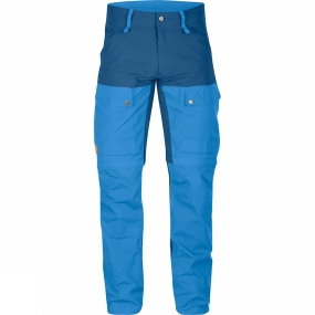 Fjallraven Technically-advanced trekking trousers with optimised fit and carefully-thought-through details and removable gaiters.In warm weather the lower section of the leg can be taken off to turn the trousers into shorts, just like a regular pair of zip-off trousers. The removed section has a drawcord adjustment at the calf that together with the boot hook in the leg ending transforms it into a gaiter that protects legs in brush-filled terrain.The fabric is stretch with G-1000 Eco at the rear, the front of the legs and over the knees for extra durability. Leg endings are also reinforced with extra hardwearing G-1000 HeavyDuty so they resist wear and tear from trekking boots.The rear and knees are preshaped and have extra strong seams. The seams on the inside of the legs have been moved forward to reduce the risk of chafing. A zipped ventilation opening from knee to hip releases excess heat and even the fly has been lengthened for extra ventilation if needed. Two leg pockets with flaps, one of which has an inner mesh pocket for smaller items such as a telephone. The hand pockets are positioned high so contents do not spill out when you sit down. Strap adjustments at the hems and, in addition to the hidden boot hook, the hems are equipped with eyelets to which laces or metal hooks can be attached - yet another way to fasten the trouser leg and prevent brush or snow from finding its way into boots.