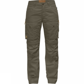 Fjallraven Advanced outdoor trousers for warm climates and high activity levels. They have the same innovative gaiter feature as Gaiter Trousers No. 1 but here we have used a lighter fabric with excellent ventilation. They are lightweight, packable trousers that are hardwearing enough to suit long adventures in difficult terrain. The gaiter feature means you can adapt the trousers to the conditions you find yourself in. When the temperature rises, the lower legs can be zipped off to give you a pair of shorts. The knee sections of the legs can be folded into the gaiters and drawcords at the back of the knees can be used to adjust the width at the top, while boothooks can be fastened to boot laces to keep the gaiters in place. In addition to the boothooks there are drawcord adjustments and eyelets to attach straps or stirrups to go under boots for extra security. Zippers along the thighs give extra ventilation. There are two spacious leg pockets with flaps plus hand pockets and back pockets with buttoned flaps. Gaiter Trousers No. 2 are made from durable, wind and water resistant G-1000 Lite Eco (recycled polyester and organic cotton) with G-1000 Eco over the rear, pockets, knees and on the gaiters. The fabric can be waxed with Greenland Wax for enhanced weather protection, or the wax can be washed out to give a cooler garment with maximum ventilation. The fabric and details have been chosen to minimise their impact on the environment - for example most of the leather details are made from leftover pieces of leather - and to make it easy to replace exposed sections after years of use. The trousers are part of the Fjällräven Numbers collection.