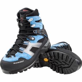 Mammut The Womens Magic High GTX Boot from Mammut is a longstanding bestseller that has been completely revised and now features an elastic fabric around the tongue, flex zone and on the heel collar. This has resulted in a huge increase in comfort and support in the boot. This effect is further enhanced by 3D-shaped heel cushioning, 3-zone lacing with efficient D-ring locking and the patented Base Fit 2.1. This is free sliding on the shoe outer above and below the heel bone using a Mammut Hammer cord, which significantly improves heel support and reduces blistering. Memo foam, an elastic Gore-Tex tongue construction and the Gore-Tex Performance Comfort Footwear membrane ensure the inside is dry and comfortable. The precise connection to the shaft is due to a light wedge made from poro, PU and TPU, which offers lasting cushioning. The proven Vibram Maton sole completes this updated crampon-compatible model, which is also suitable for demanding mountain hikes.