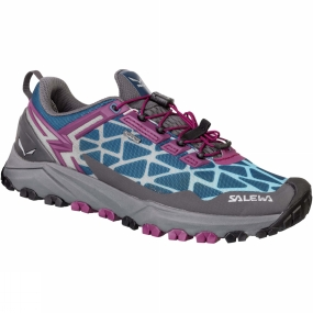 Salewa The Womens Multi Track GTX Shoe is a low-cut, lightweight breathable mountain training shoe with a Michelin outsole that covers a wide range of activities: speed hiking, mountain training or other high-octane mountain sports.Its hybrid design meets the demands of three different sports: hiking, running and mountain biking. Perfectly at home on rough and uneven terrain such as rocky trails, mud or grass, the Multi Track offers the stability of a hiking shoe, the cushioning of a running shoe, and MTB flat pedal-compatibility - thanks to the specially designed tread pattern under the forefoot.Its hardwearing and sure-grip Multi Track outsole was developed in partnership with Michelin.The Multi Track combines a weight-saving, minimalist upper with a cushioning midsole with TPU injected inserts. It benefits from Salewa