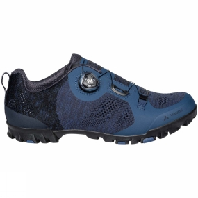 Vaude The Mens TVL Skoj Shoe from Vaude have a dial closure system provides a micro-adjustable, secure fit and easy handling even while riding. An Ortholite insole, reinforced in the pedal area with harder PU foam for better pedal pushing power, offers optimal support and comfort. To keep you safe while riding, reflective elements at the heel enhance your visibility in low light conditions. The innovative SUPtraction R20 outsole made from 20% recycled rubber has a high traction lug profile for outstanding grip in both wet and dry street conditions. Medium stiffness (V-Flow 5) in the sole ensures efficient power transfer to the pedal while also allowing for comfortable walkability. A removable cleat cover makes this shoe compatible with most clipless systems.